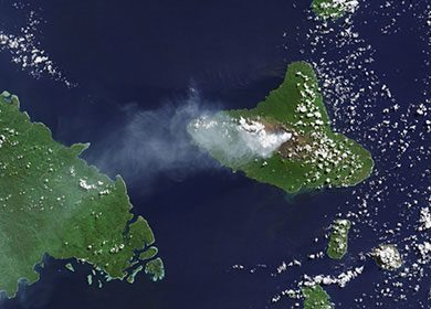 The Ambrym Volcano in the archipelago of Vanuatu expelling a stream of aerosols into atmosphere. Courtesy of NASA Earth Observatory.