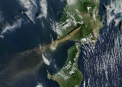 The Raung Volcano on the island of Java in Indonesia emitting gases into the atmosphere. Courtesy of NASA Earth Observatory.