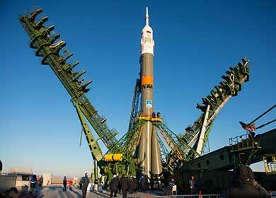 The Soyuz TMA-15M spacecraft securing at the rocket launch pad. Courtesy NASA and Aubrey Gemignani.