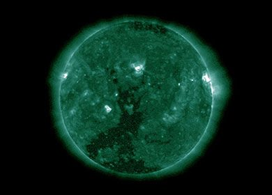 A filtered image of the sun comprised of green wavelengths of light. Courtesy of NASA.