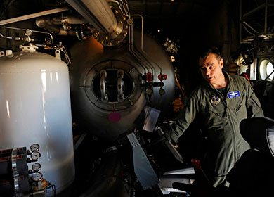 The Modular Airborne Firefighting System aboard a C-130J Hercules. Courtesy of U.S. Air Force Staff Sgt. Eric Harris.