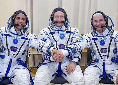 Astronauts prepare for a Expedition 53 launch on a Soyuz rocket in 2017. Courtesy NASA, GCTC and Irina Peshkova.