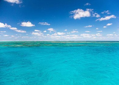 Clouds over a shallow reef.