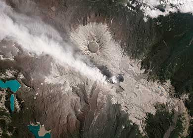 The Puyehue Cordon Volcano in Chile expelling a stream of gases. Courtesy of NASA Earth Observatory.