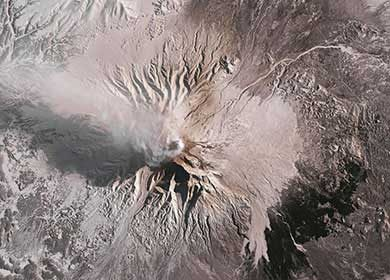 The Shiveluch Volcano in northeast Russia expelling aerosols in the atmosphere. Courtesy of NASA Earth Observatory.