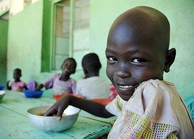Child eating lunch at the Juba Orphange, Juba, November 19 2006.
