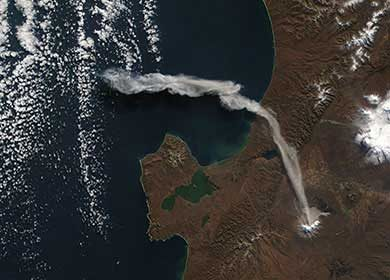 Volcano Shiveluch in Kamchatka Krai, Russia releasing aerosols into the atmosphere. Courtesy of the NASA Earth Observatory.